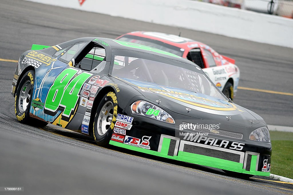 J.R. Fitzpatrick, driver of the #84 Equipment Express Chevrolet, drives during practice for the NASCAR Canadian Tire Series race at Barrie Speedway on September 7, 2013 in Oro Station, Ontario, Canada.