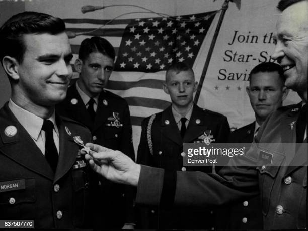 Fitzsimons Hospital Commander Maj Gen Robert E Blount Right Admires Silver Star Award He had pinned Army medal on Pfc Norman A Morgan of La Junta...