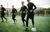 Football players training in soccer field. Five a side soccer team practicing during training session.