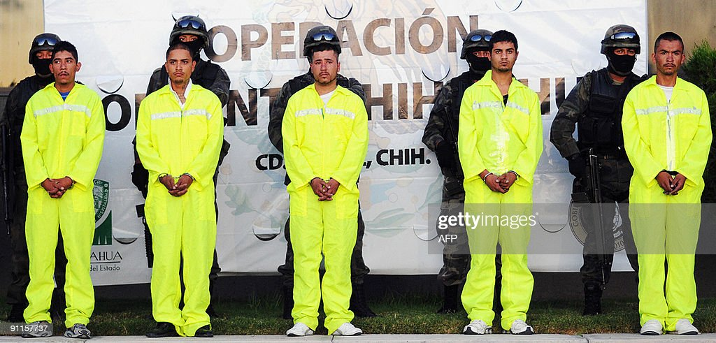 Five alleged members of the drug trafficking gang 'Cartel de Sinaloa' are presented to the press in Ciudad Juarez Mexico on September 25 2009 The...