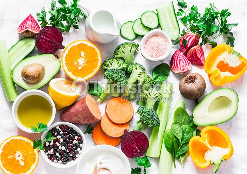 Five best vitamins for beautiful skin. Products with vitamins A, B, C, E, K - broccoli, sweet potatoes, orange, avocado, spinach, peppers, olive oil, dairy, beets, cucumber, beens. Flat lay, top view : Stock Photo