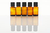 Five bottles of aromatherapy oil side by side