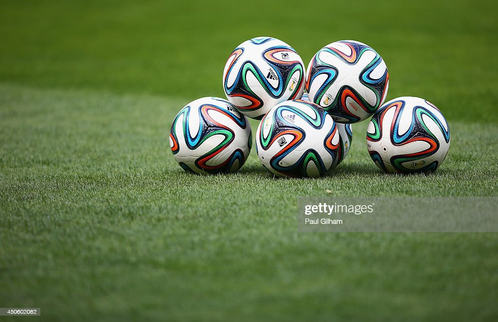 Five 'Brazuca' match balls sit on the field prior to the 2014 FIFA World Cup Brazil Group C match between Colombia and Greece at Estadio Mineirao on June 14, 2014 in Belo Horizonte, Brazil.