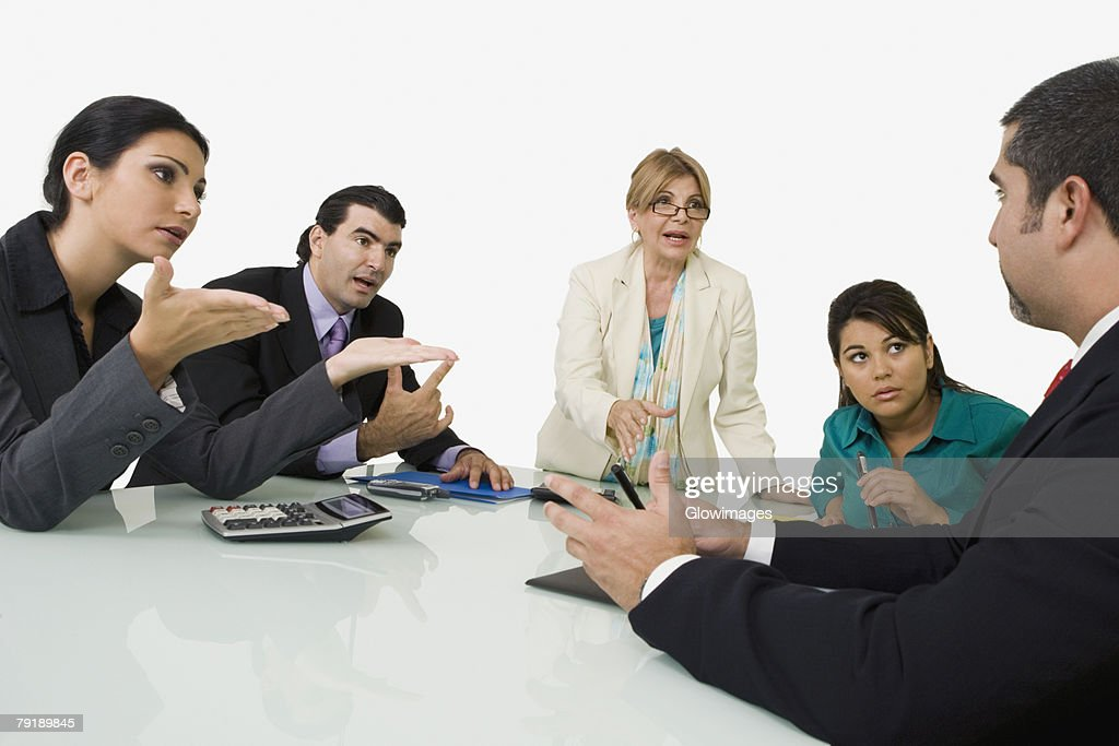 Five business executives discussing in a meeting : Stock Photo