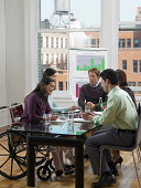 Five Business Executives In a Conference Room Meeting