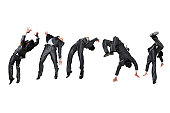 Five businessmen flipping in the air