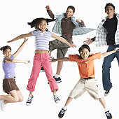 Five children (8-14) jumping in midair (Digital Composite)