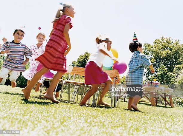 Five Children Playing a Game at a Birthday party