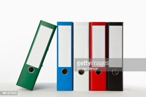 Five colored ring binders