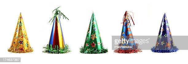 Five colorful party hats on a white background