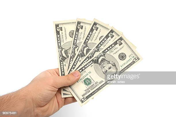 Five dollar bills held in a man's hand