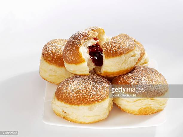 Five doughnuts on a serving plate