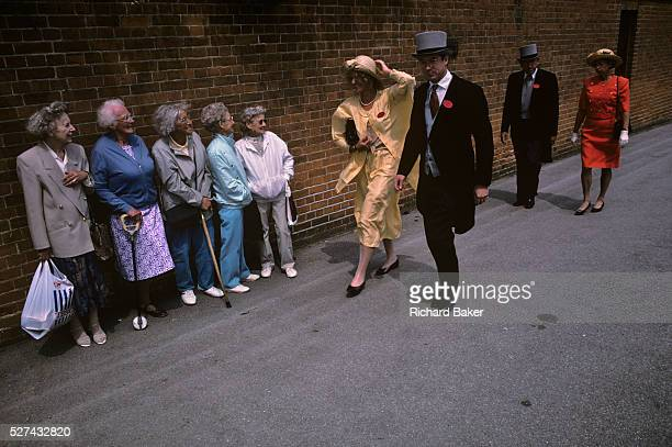 Five elderly women onlookers are lined against a wall outside the famous Ascot race course on Ladies' Day the annual event on the English sporting...