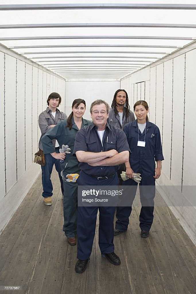 Five factory workers : Stock Photo