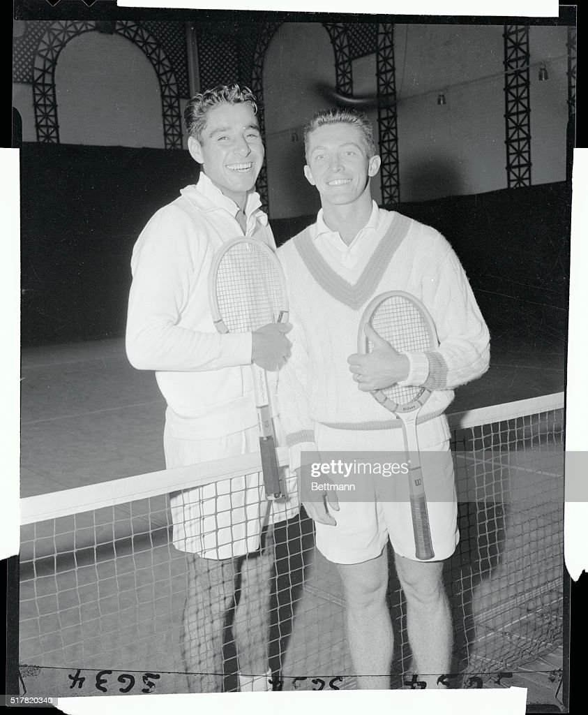 Dick Gonzales and Tony Trabert Posing by Net with Racket