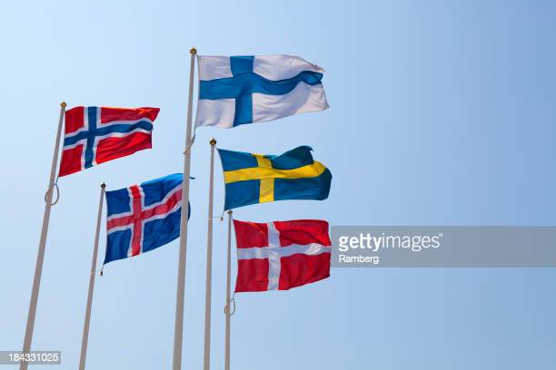 Five flags of Nordic Countries blowing in the wind