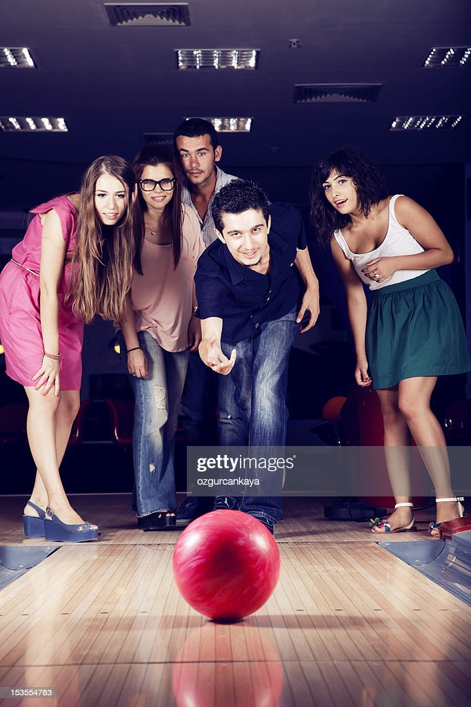 Five friends at a bowling alley