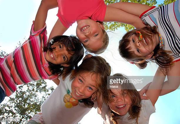 Five friends huddling
