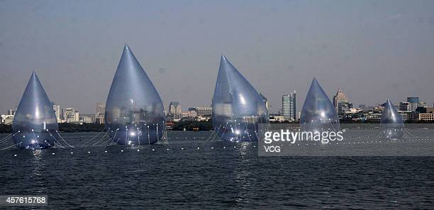 Five giant water dropshaped airfilled models are placed on West Lake on October 19 2014 in Hangzhou China A performing art exhibition of 'Dancing...