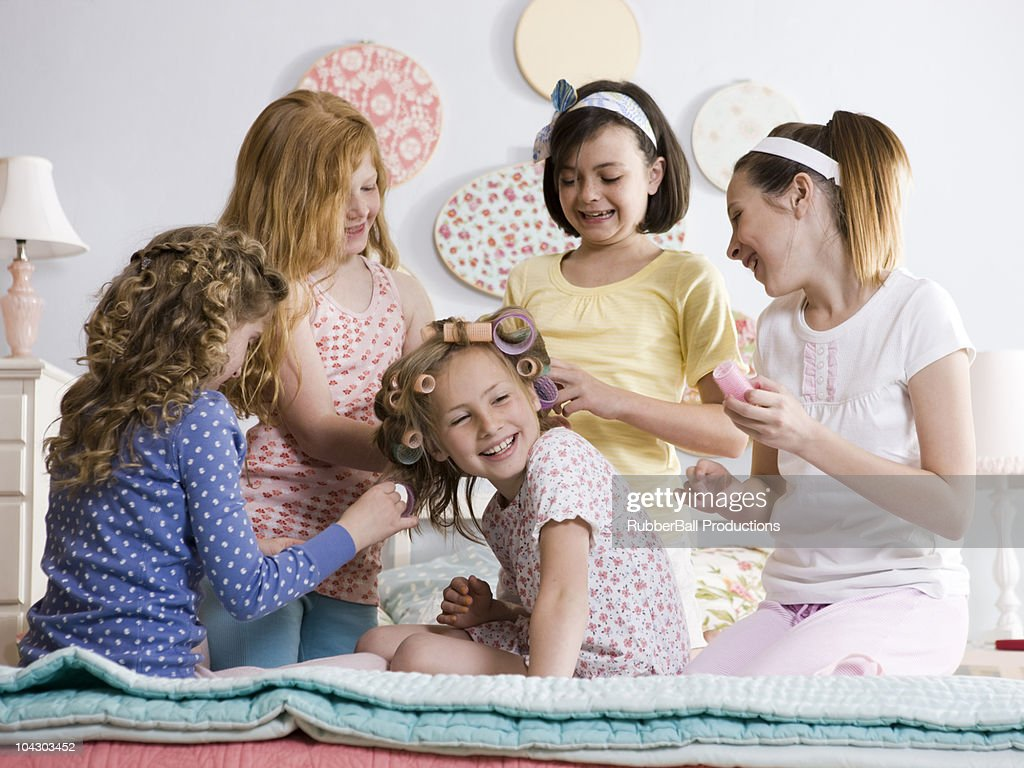 five girls on a bed : Stock Photo