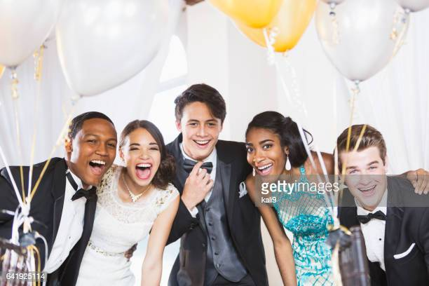 Five happy teenagers at formal party