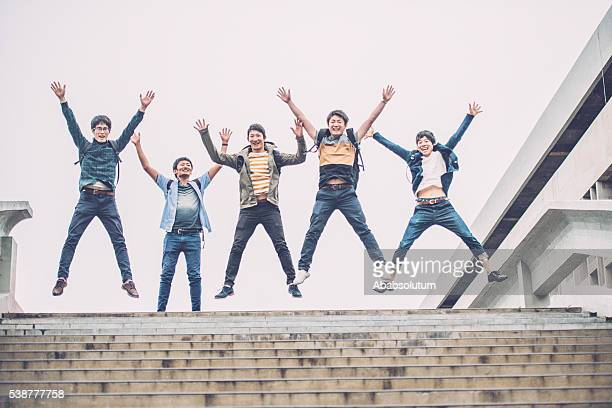Five Japanese Students Jumping, Campus, Kyoto, Japan, Asia
