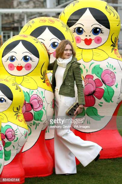 Five largescale Russian nesting dolls known as Matryoshka are unveiled by Londonbased Russian supermodel Natalia Vodianova beside the British Airways...