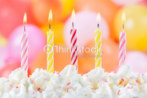 five lit birthday candles stock photo thinkstock
