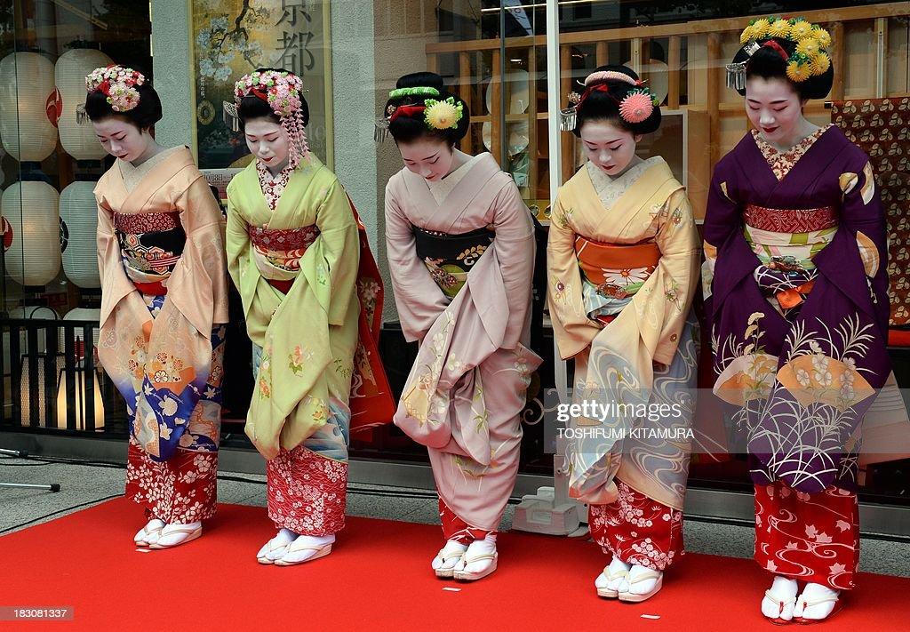 Five 'Maiko,' or apprentice geishas, (from L-R) Ichitomi from Gion Kobu, Toshitomo from Miyagawa cho, Chizu from Ponto cho, Ichimari from Kami Shichiken and Tomitae from Gion Higashi, bow while attending 'We're alive and well, Kyoto' campaign in Tokyo on October 4, 2013. As Kyoto prepares itself for the biggest sightseeing season of autumn, the girls lent their charms to lure back tourists to the 1,200-year-old city after a big typhoon flooded some of scenic spots there three weeks ago.