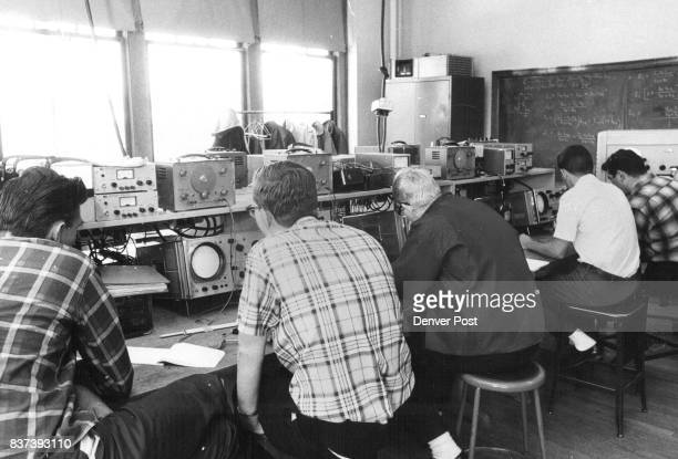 Five members of the technical electronics class are measuring the output resistance of the signal generators during class From left they are Richard...