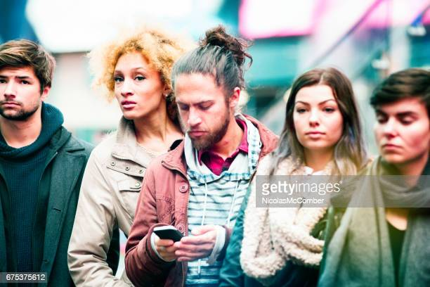 Five millennial young adults waiting for the bus