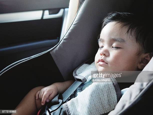Five month old baby sleeping or asleep in car seat