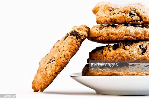Five oatmeal cookies on white background