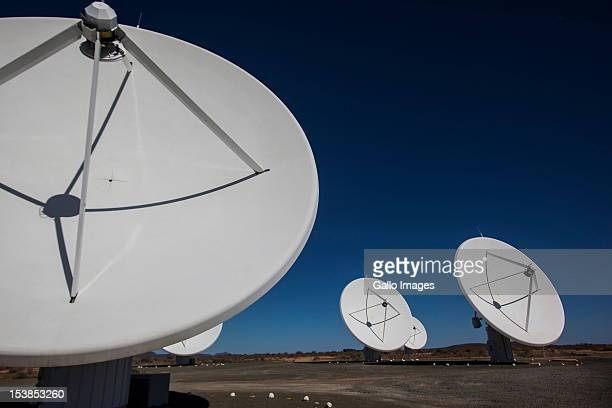 Five of the seven satellite dishes that make up the KAT radio telescope stand at Square Kilometre Array on October 9 2012 in Carnarvon South Africa...