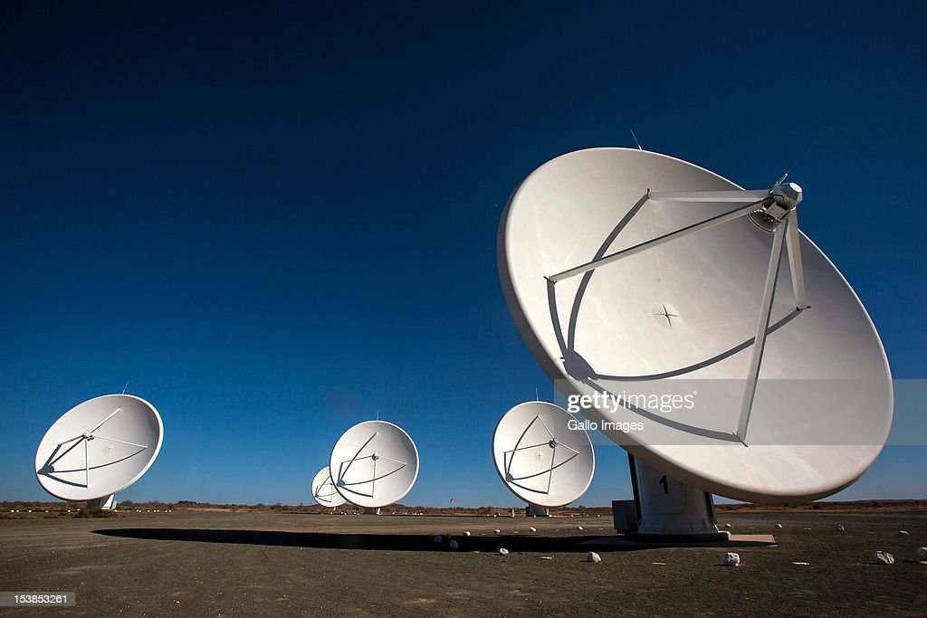 Five of the seven satellite dishes that make up the KAT radio telescope stand at Square Kilometre Array (SKA) on October 9, 2012 in Carnarvon, South Africa. The Square Kilometre Array telescope will be built here and it will be the largest telescope in the world.