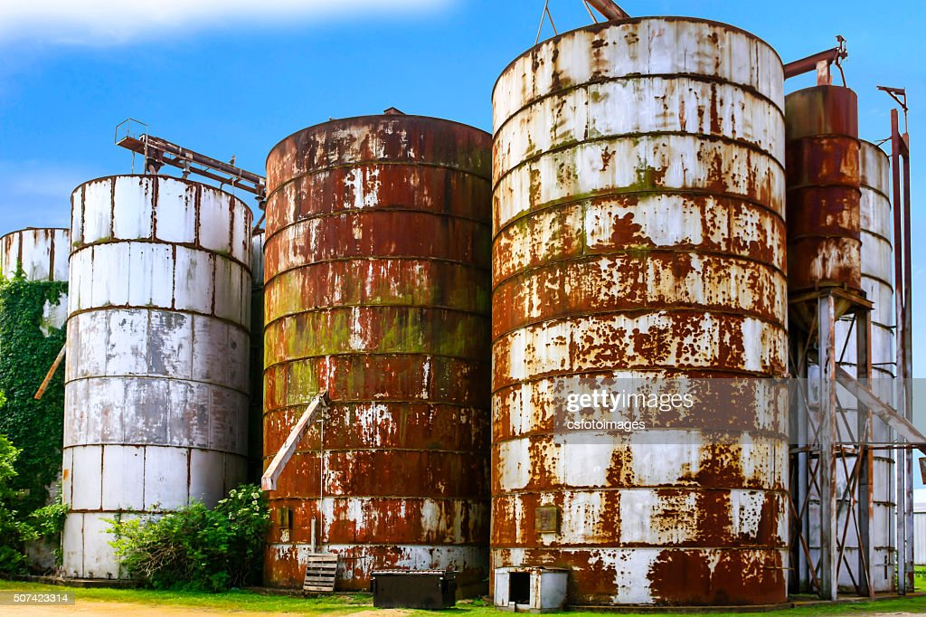 Five Old Rusting Graon Silos In Indianola MS : Stock Photo