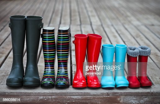 Five pairs of a colorful rain boots : Stock Photo
