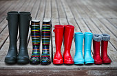 Five pairs of a colorful rain boots. Family concept
