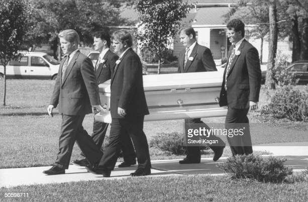 Five Pallbearers carrying the coffin of murder victim Michael Moore fr the Holy Cross Episcopal Church where his funeral was held Michael's ravaged...