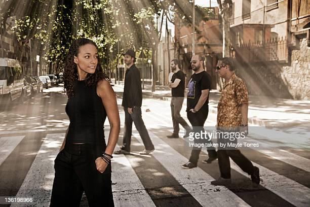 Five people crossing street