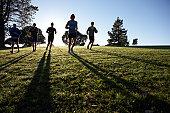 Five people jogging in park