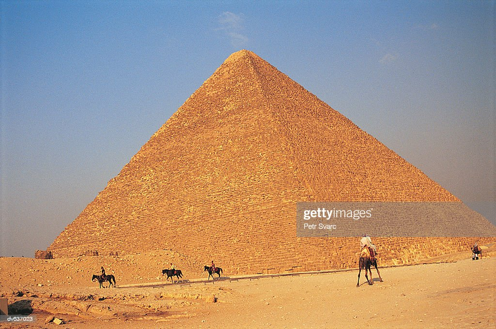 Five People Riding Horses in Front of the Cheops Pyramid, Giza, Egpyt : Stock Photo