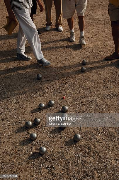 Five person playing petanque game AlpesMaritimes France