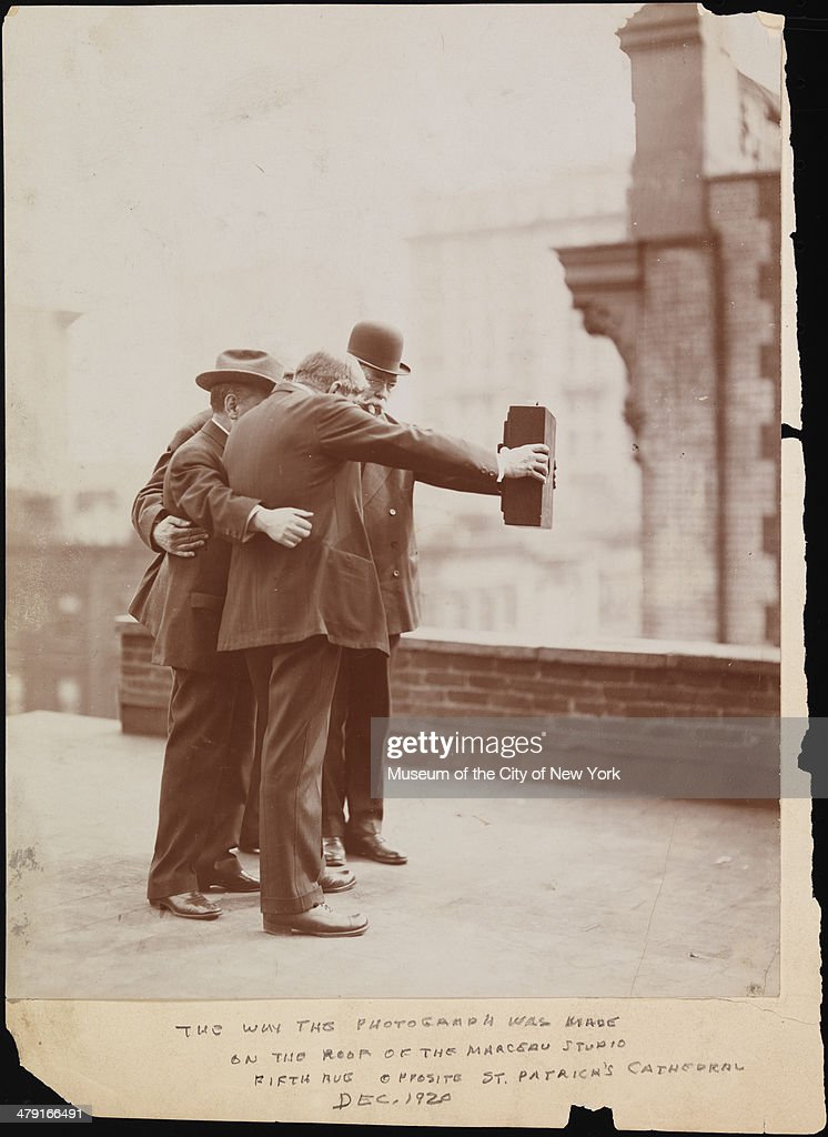 Five photographers on the roof of Colonel Marceau's photography studio prepare a group self-portrait, New York, December 1920. Among those visible are Joseph Byron, who holds one side of the camera with his right hand, and Ben Falk, who holds the other side with his left hand.