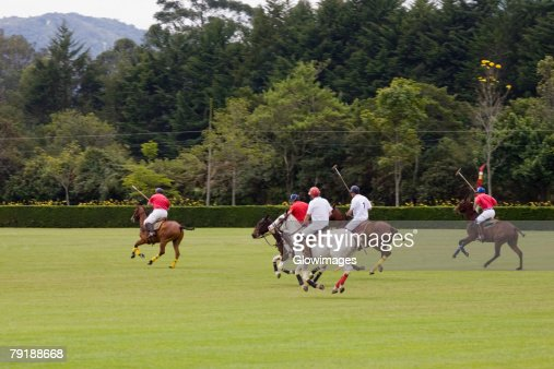 Five polo players playing polo : Stock Photo