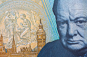 Close up of the new water proof polymer five pound note, showing the head of Sir Winston Churchill on the reverse side.