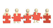 Success of teamwork. Five 3d mans with part of puzzles of red color. Isolated on white background. 3d render