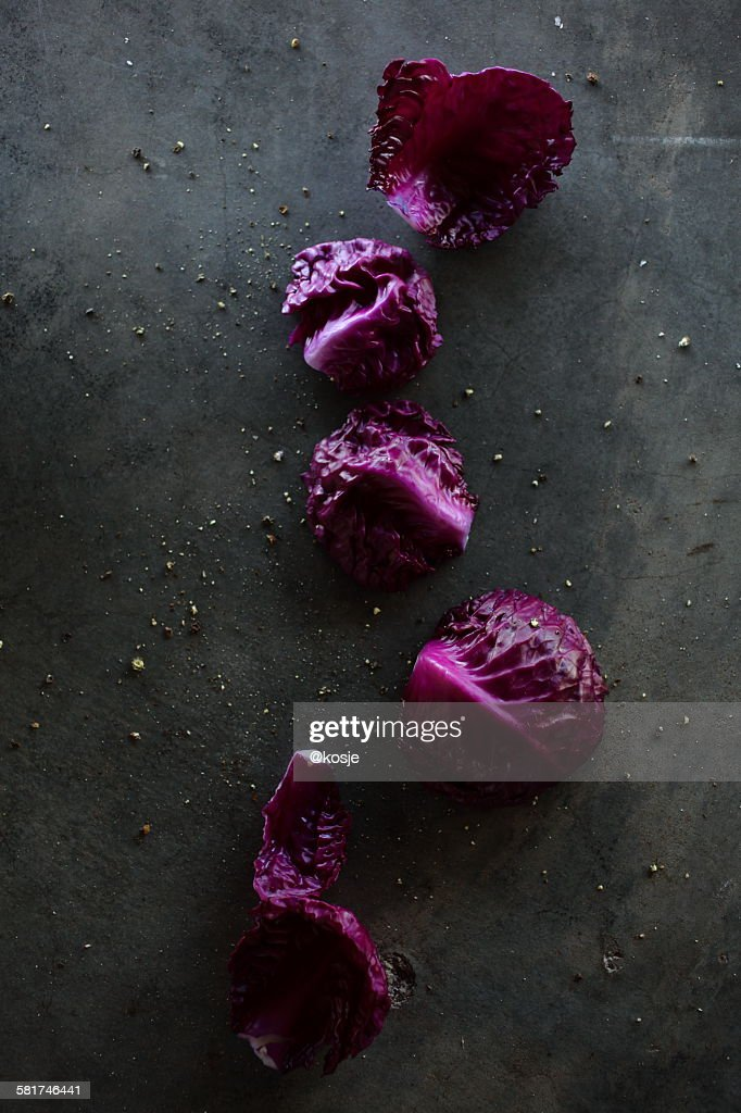 Five red cabbage leaves in a row