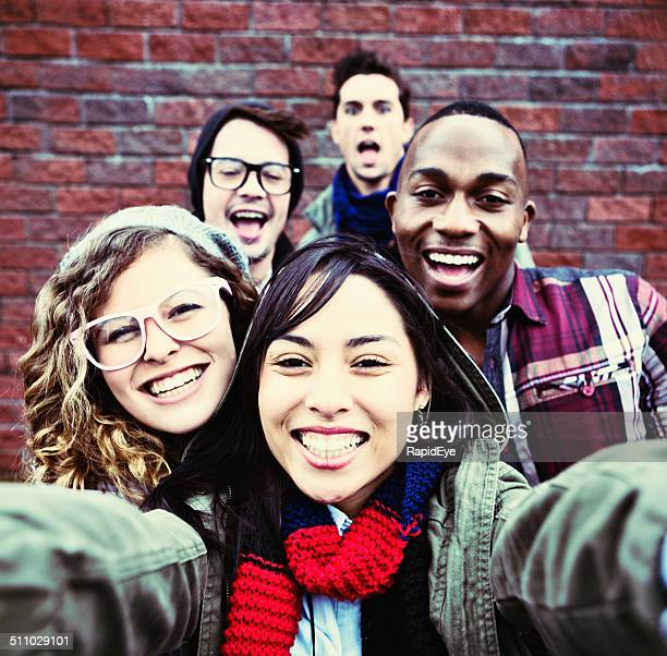 Five smiling youngsters take happy Selfie