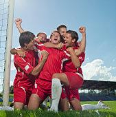 Five soccer player celebrating